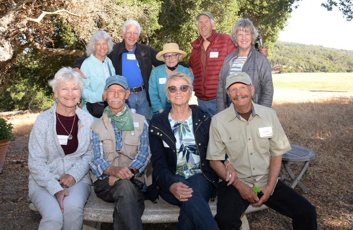 Ten-year docents casual at beginning of event